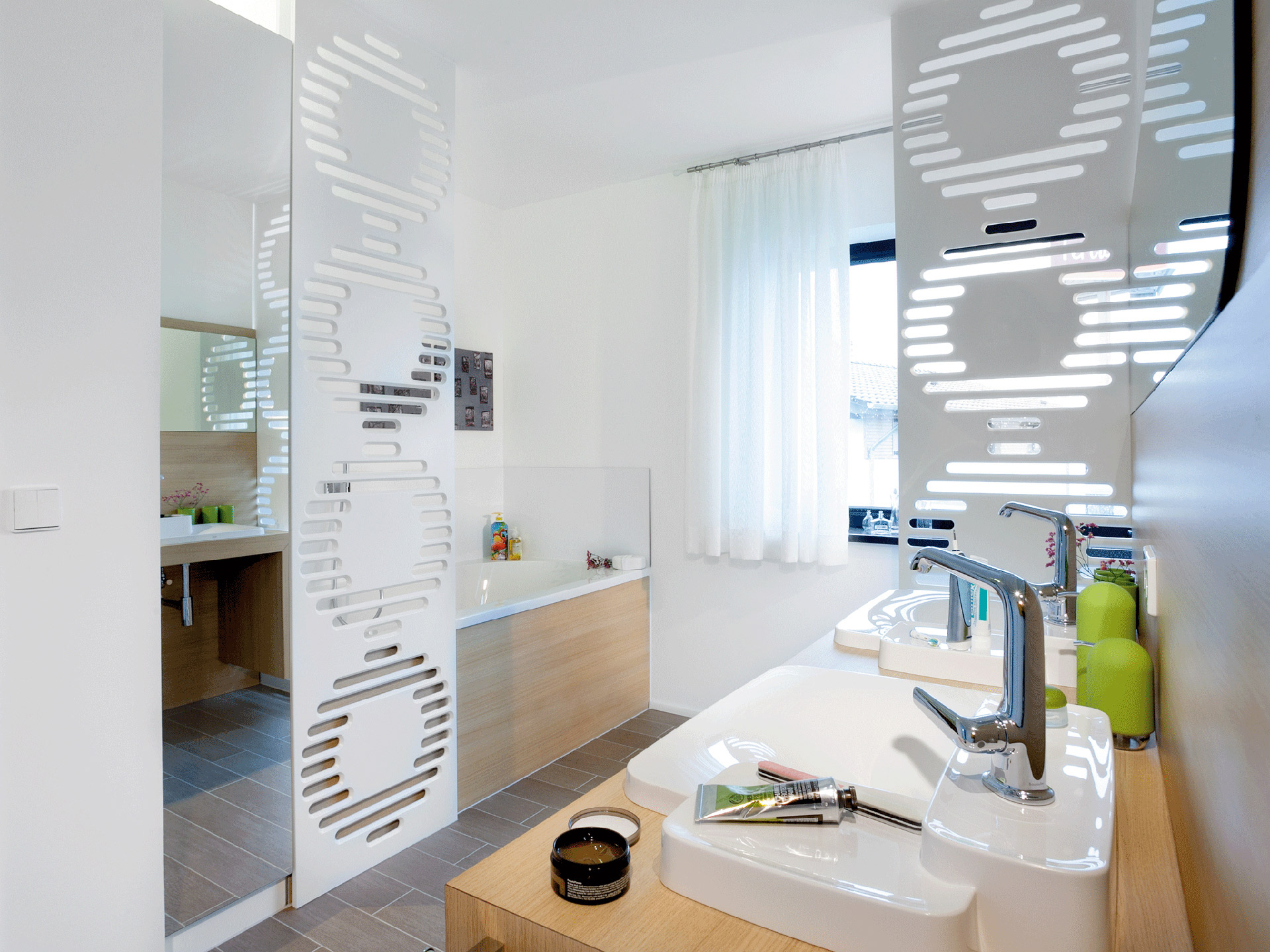 a lot of bath in a small space,  elegantly solved with room divider