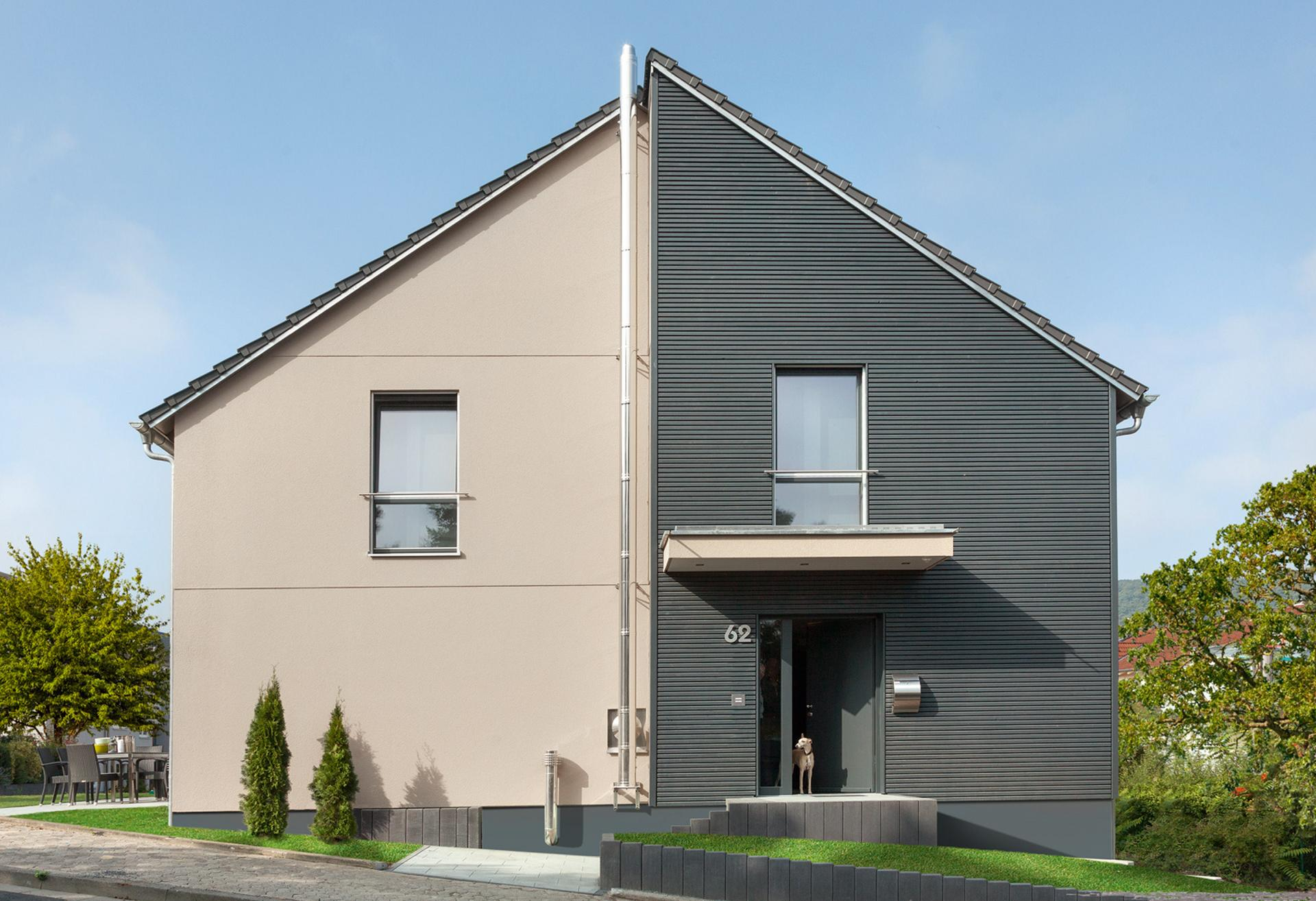 Modern detached house in Bauhaus style and pitched roof