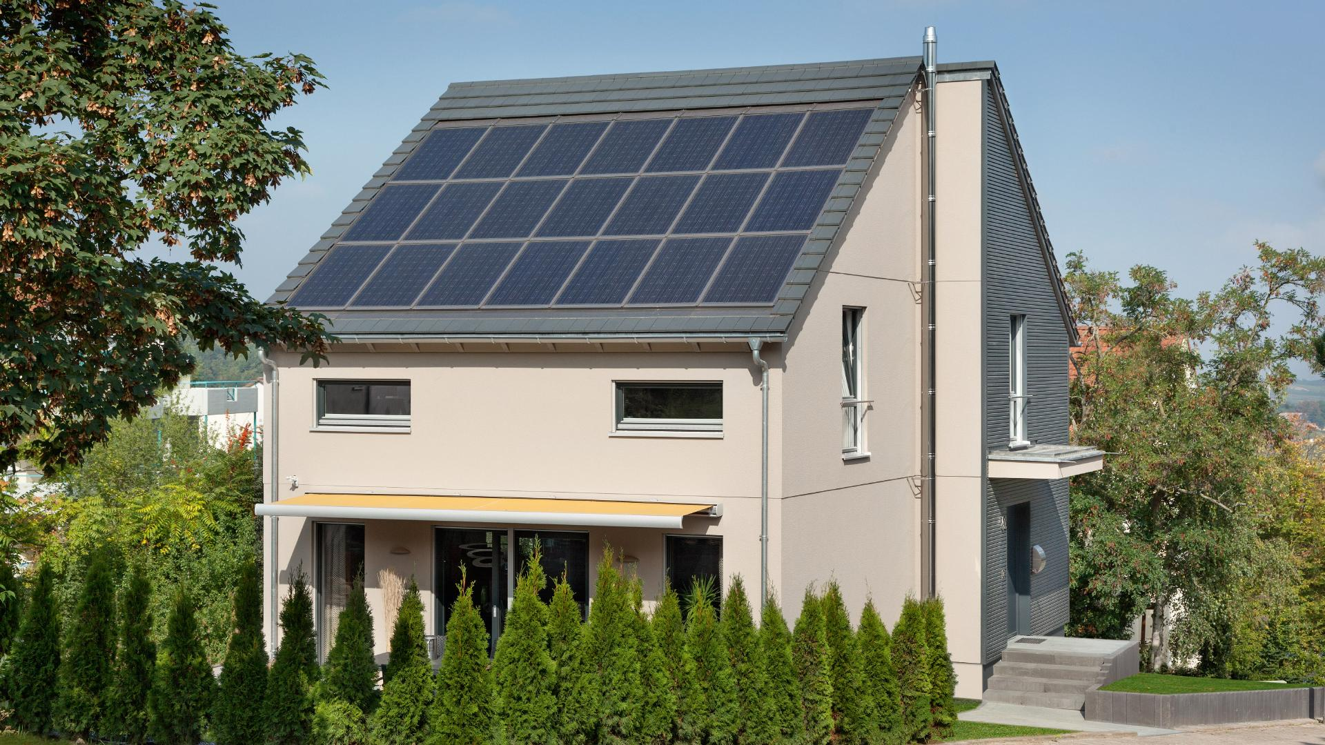 Plus energy house with photovoltaic in-roof system