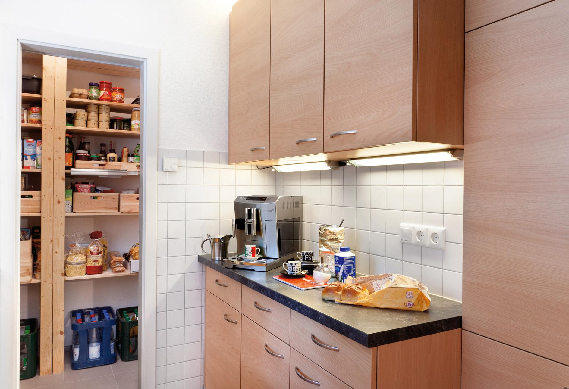 Kitchenette with wooden fronts and pantry