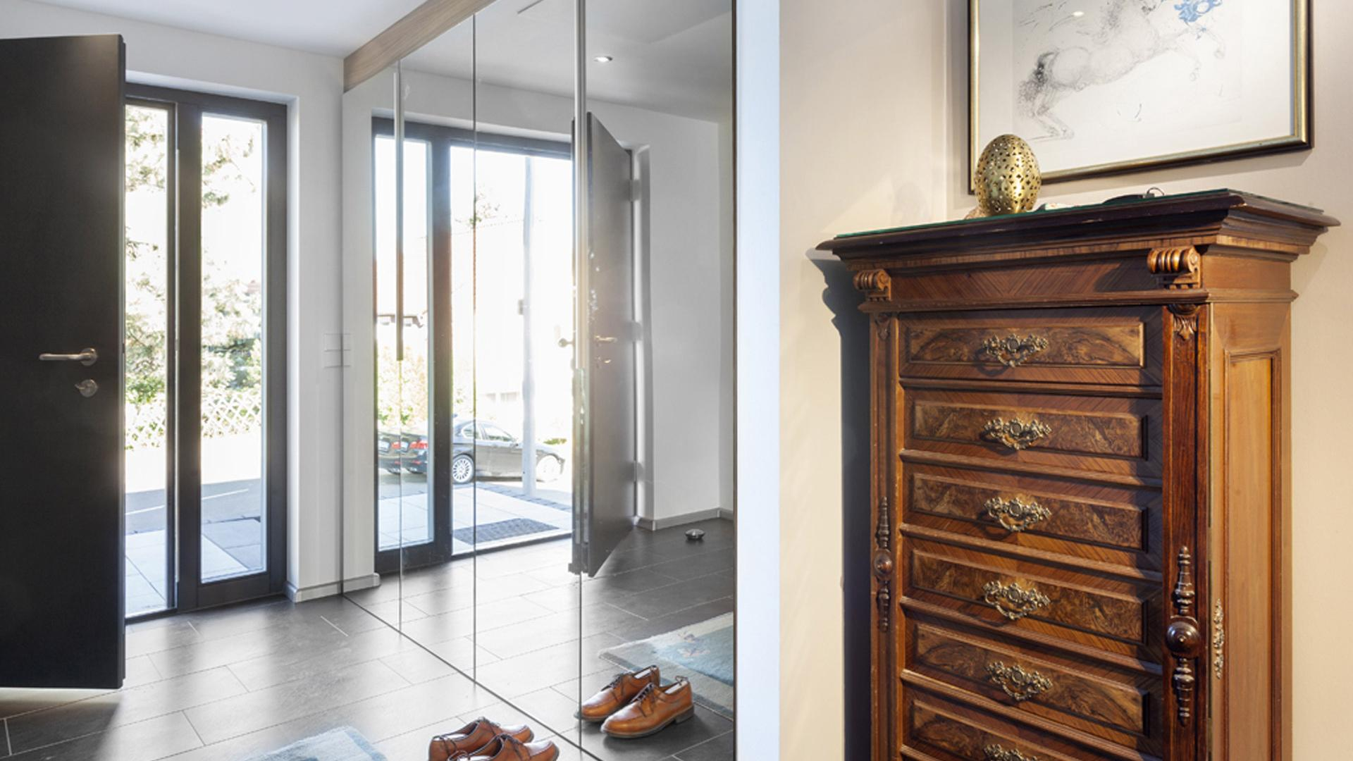 House entrance with large mirrored wardrobe