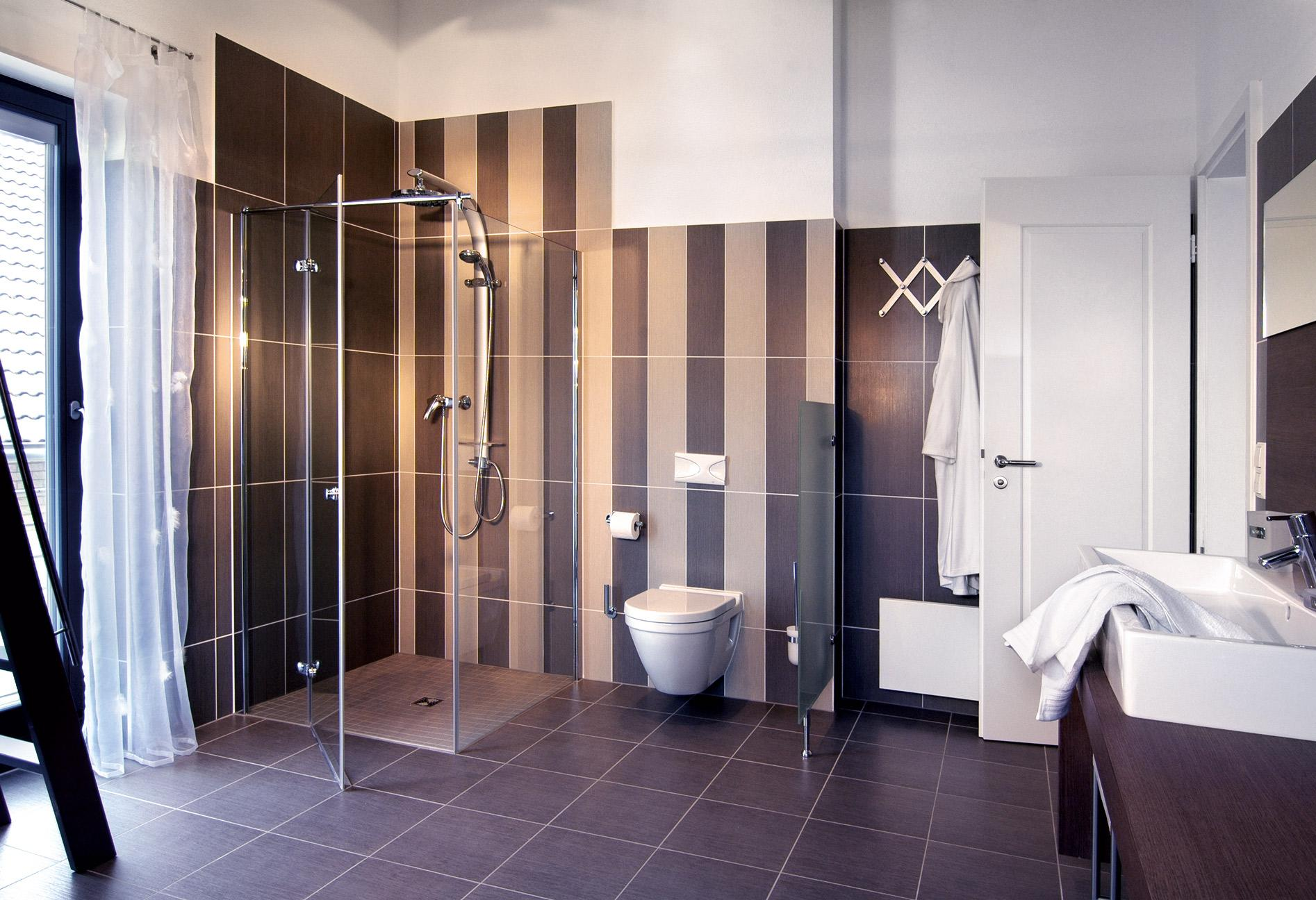 Large bathroom with dark tiles