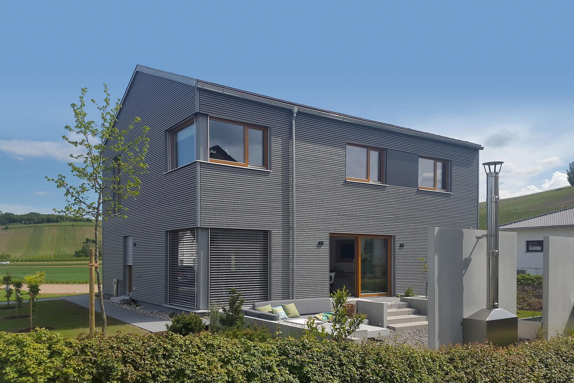 Rivestimento Casa In Legno casa con rivestimento in legno | e 20-180.5 | schwörerhaus