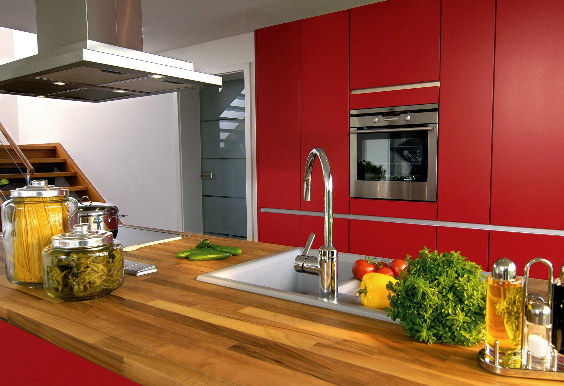 Red kitchen with wooden counter