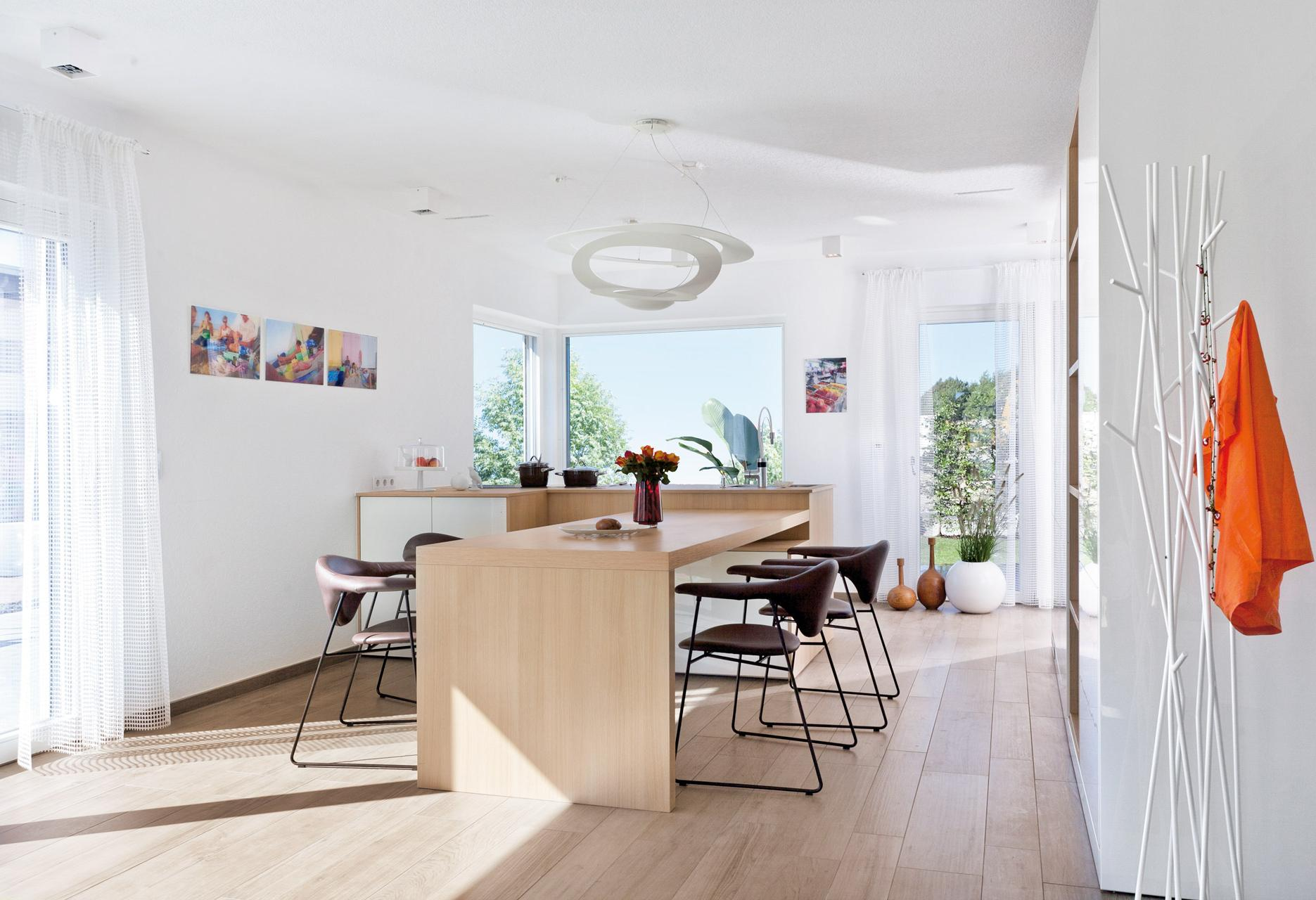 Open designer kitchen with dining area