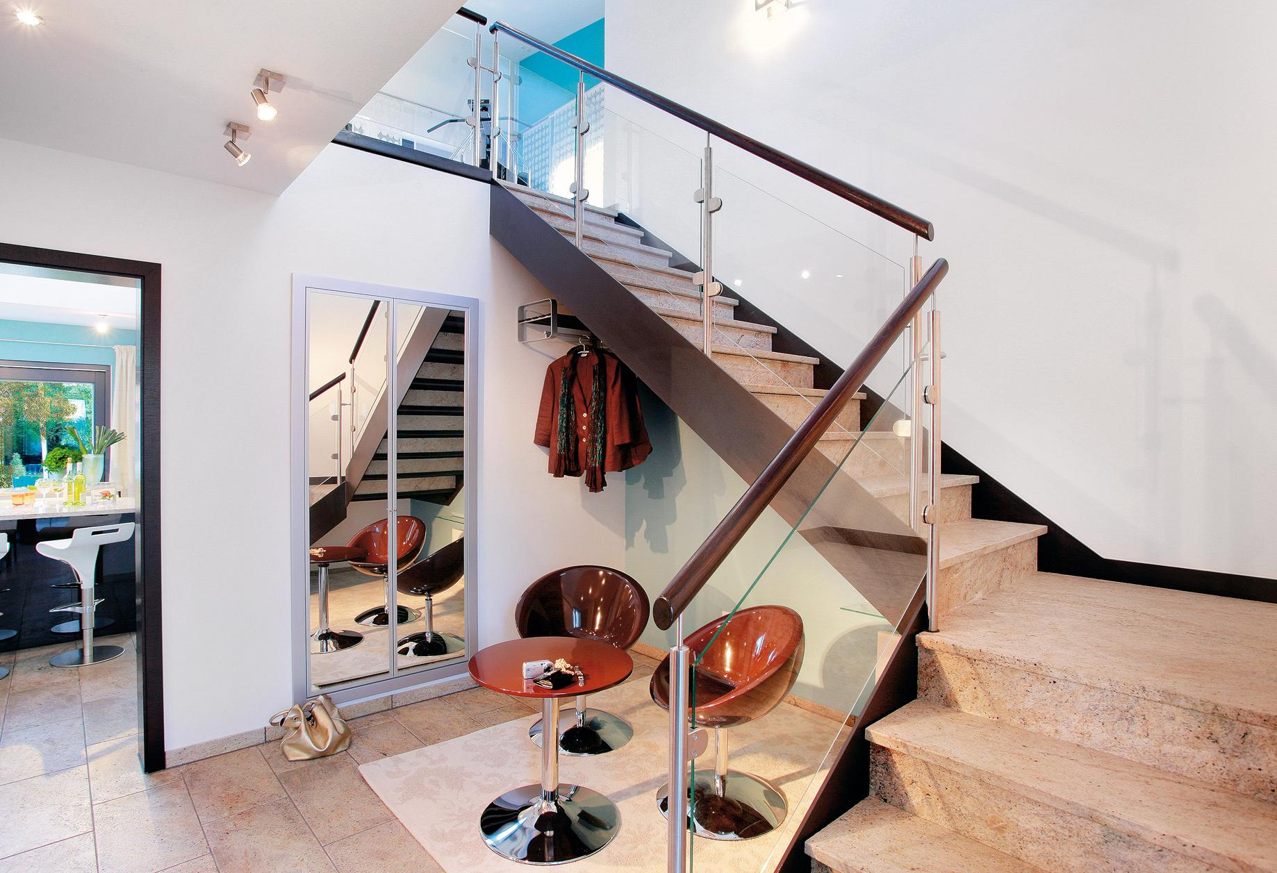 Spacious entrance with stone staircase
