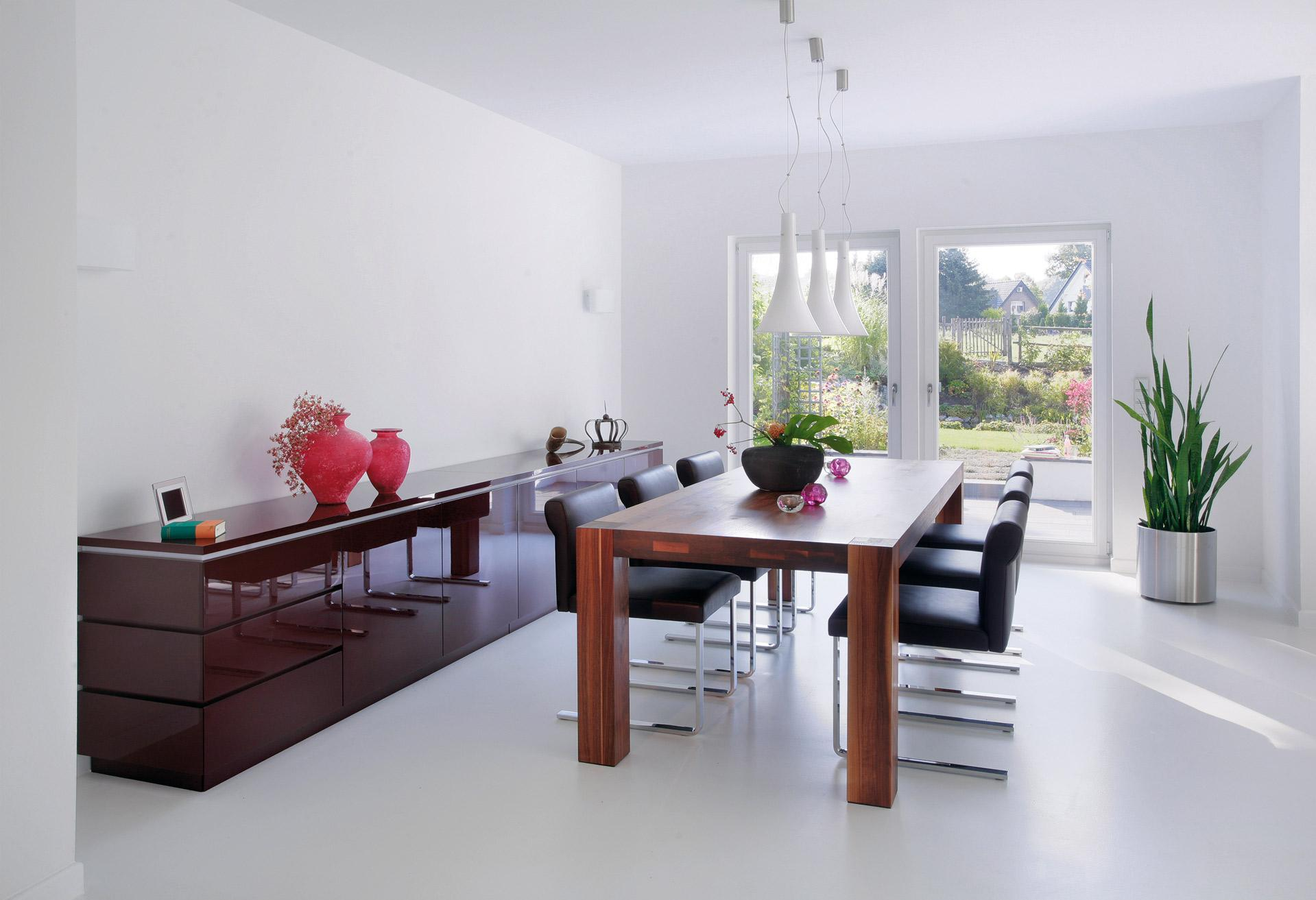 Bright dining room in white with high-quality designer furniture