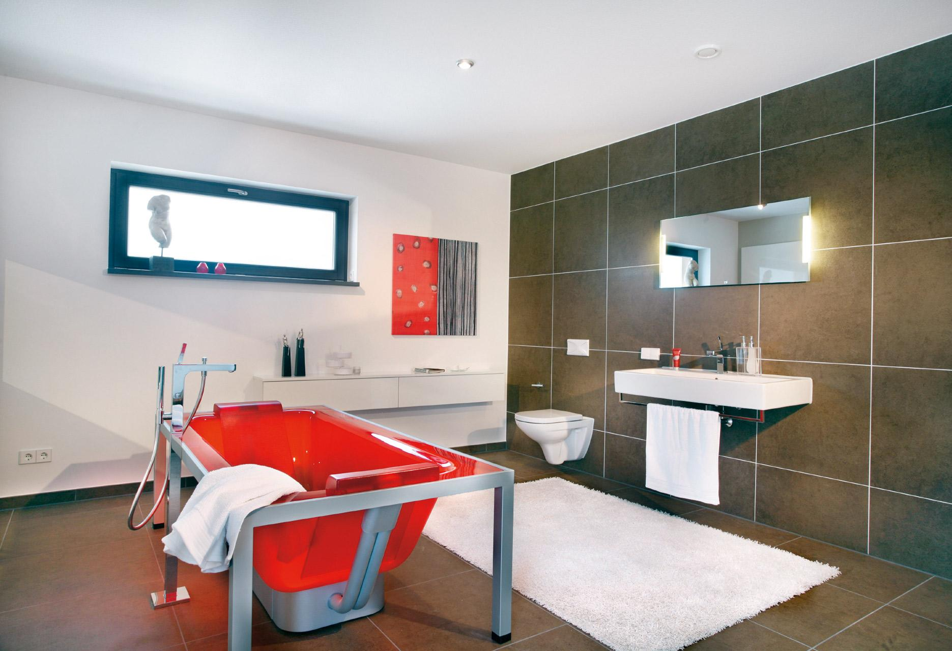 Designer bathroom with red freestanding bath
