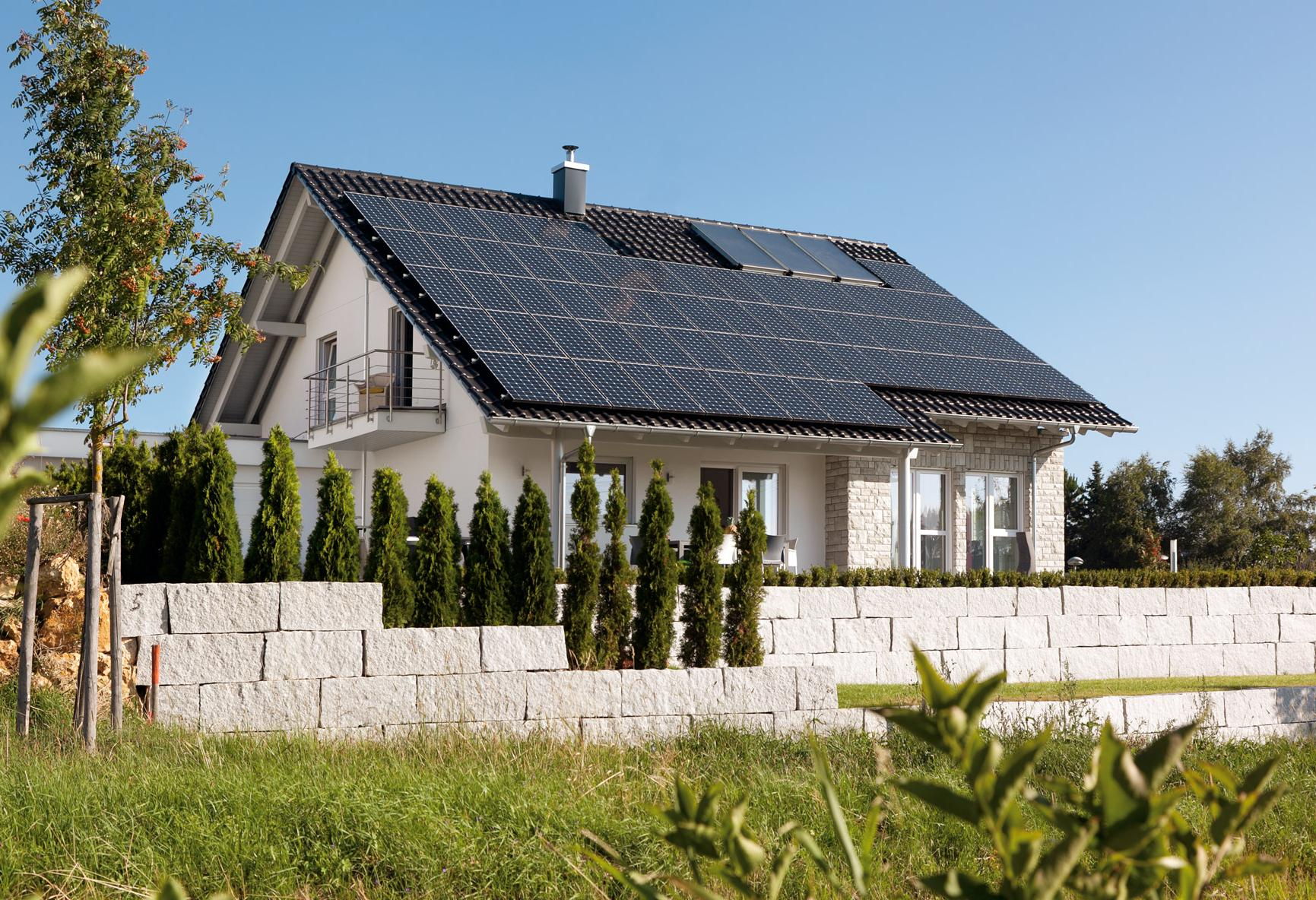 Plus energy house with in-roof photovoltaic system